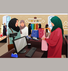 Muslim women shopping in a clothing store vector