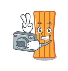 photographer air mattress mascot cartoon vector image
