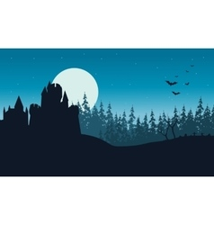 Silhouette of castle and forest halloween vector
