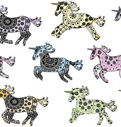Seamless with cartoon unicorns over a white vector image