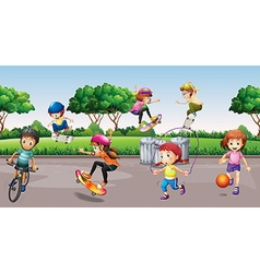 Children playing sports in the park vector