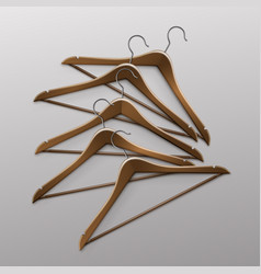 Pile of lying clothes coat brown wooden hangers vector