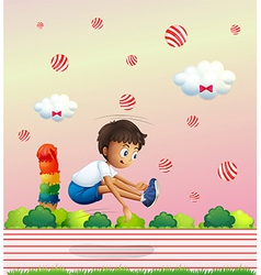 A boy exercising in the candyland vector