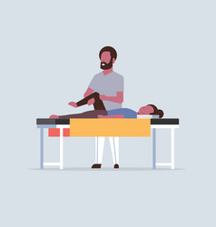 Young girl lying on massage table african american vector