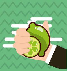 hand holding lemon fresh colored background vector image