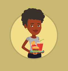 woman holding tray full of fast food vector image