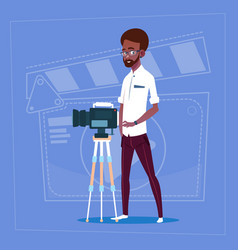 african american man holding camera on tripod vector image