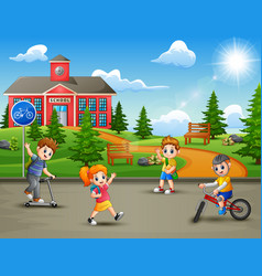 Happy kids playing in front of the school building vector