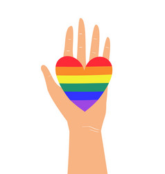 Hand holding lgbtq rainbow heart colors concept vector