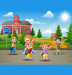 Happy school children in the road to school vector