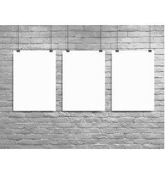 three poster mockup white brick wall loft vector image