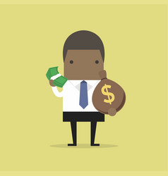 african businessman holds in hand money vector image