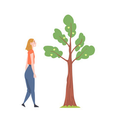 Young woman standing near fruit tree and watching vector