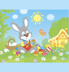 little bunny painting easter eggs vector image