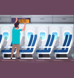Man passenger putting luggage on top shelf travel vector