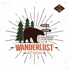 Vintage hand drawn wanderlust emblem with bear vector