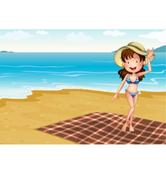 A girl in the beach with blanket vector