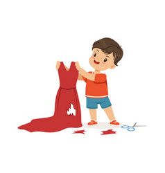 cute little bully boy cutting red mothers dress vector image