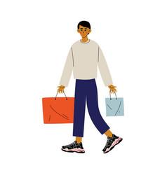 Young man walking with shopping bags guy shopping vector