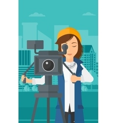 Camerawoman with movie camera on a tripod vector image