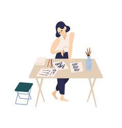 Joyful woman holding pen practicing calligraphy vector