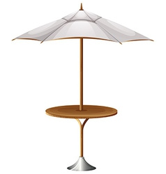 A table with a beach umbrella vector