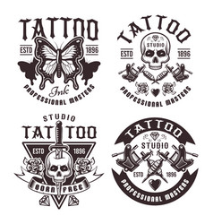 Tattoo studio set of four vintage emblems vector