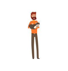 young man holding sleeping cat pet in his hands vector image