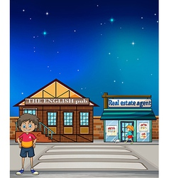 A boy standing in the street vector image