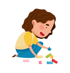 Cute girl sitting on floor in playroom and playing vector