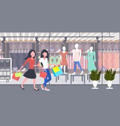 women carrying shopping bags girls couple having vector image