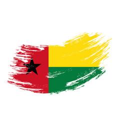 guinea-bissau flag grunge brush background vector image