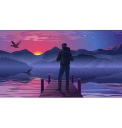 Man on the pier admiring the sunset vector image