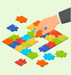 isometric colorful jigsaw puzzle and hand holding vector image