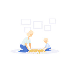 mother and little kid solving jigsaw puzzle vector image