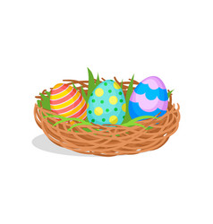 three painted easter eggs in brown nest with green vector image