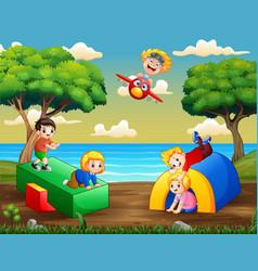 Cartoon children having fun at playground vector