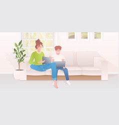 mother with son using laptops happy family vector image