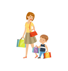 Little boy helping his mother carry shopping bags vector