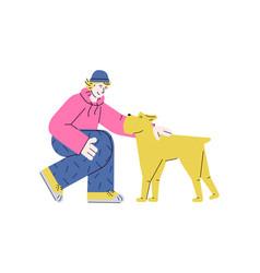 Young teenage man petting yellow dog - flat vector