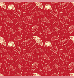Seamless pattern with umbrellas on red background vector