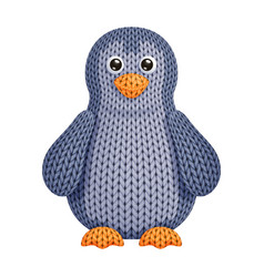 A funny knitted penguin toy on white background vector