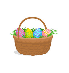 painted easter eggs and green grass in wicker vector image