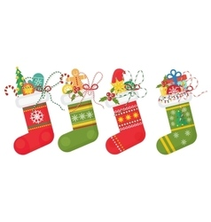 Set of Christmas socks in red andd green vector image