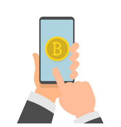 Hands holding phone with bitcoin icon on screen vector