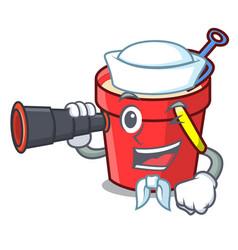 Sailor with binocular sand bucket mascot cartoon vector