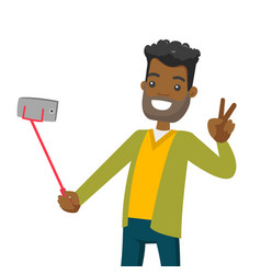 a black man making selfie on his cellphone with a vector image
