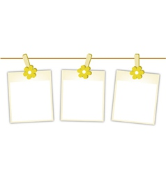 Blank Photos with Yellow Flowers on Clothesline vector image