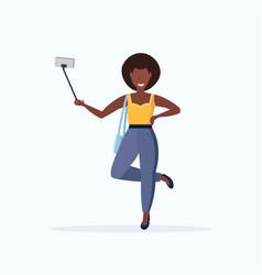 woman using selfie stick african american girl vector image