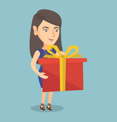 young caucasian woman holding a box with gift vector image